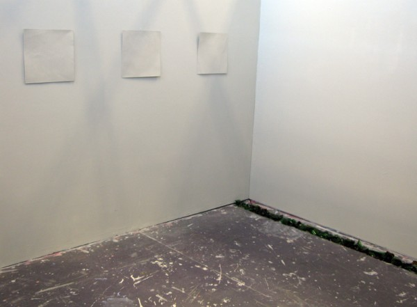 """""""Pigeon-hole"""" 2008: Installation of 12 etchings, grey painted wall, broken bottles. each print 30 x 30 cm"""