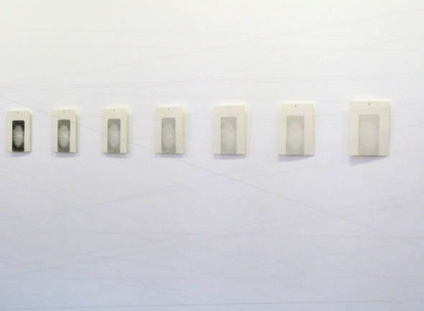 """""""Cut"""" 2009 (installation of around 40 relief prints made directly from chopping-board, the image is gradually fading away, in front of the prints there is a thread cutting the air. each print) 28 x 22 cm"""