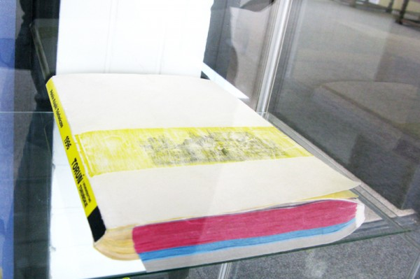 """A couple"" 2011 (UK phone book and Polish phone book. 29.5 x 23 x 4 cm)"
