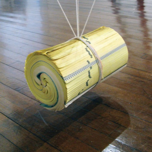 """""""Pull"""" 2010 phone book and string. approx 30 x 21 x 21 cm"""