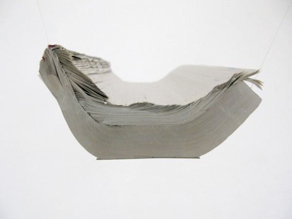 """""""Flying boat"""" 2011 (Phone book, metal plate, thread. 20 x 9 x 29.7 cm suspended off the wall)"""