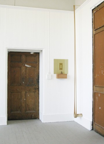 """fragment of the """"Icarus"""" installation: to the right: """"Suspension"""" 2010 old book, thread, roll of gum tape. 313 x 22 x 12 cm"""