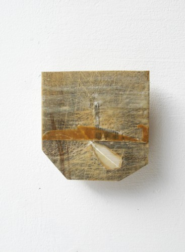 """""""Submarine"""" 2011 (relief print, paper, shuttlecock feather and beeswax on wood. 12 x 11.5 cm)"""